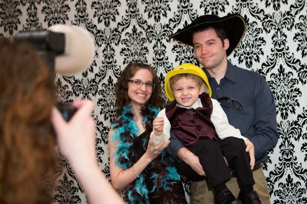 family and kid enjoying a photo booth in dallas /  fort worth