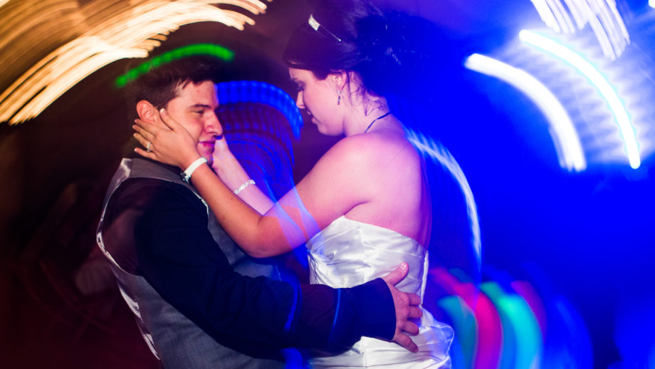 wedding photography and video in dallas of a married couple dating to the DJ's music.